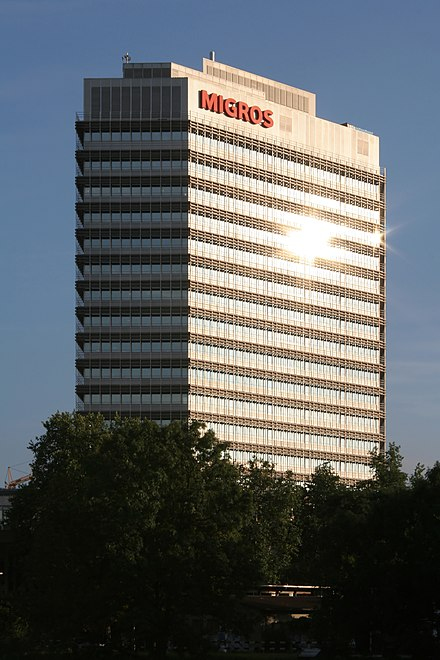 The two largest supermarkets chains in Switzerland, Migros and Coop, are cooperatives. The third largest bank, Raiffeisen, is a cooperative as well. Zuerich Migroshochhaus 5.jpg