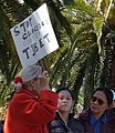 """STOP GENOCIDE IN COMMIE TIBET"" sign detail at 2008 Olympic Torch Relay in SF - Embarcadero 03 (cropped).JPG"