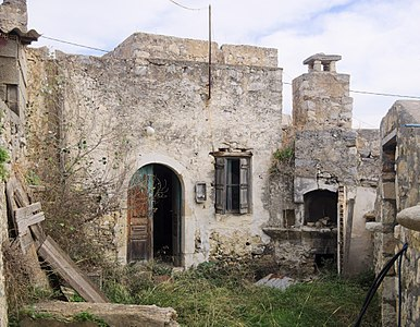 Abandoned traditional house in Kainourio Chorio, with exterior oven