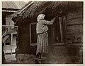 Казачка чинит окно. Цымлянская станица. 1875-1876.jpg