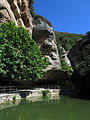 091 Sant Miquel del Fai, estany sota la cinglera i el salt d'aigua del Rossinyol.JPG