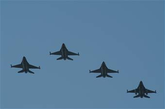 """Finger-four - Four F-16s of the USAF 457th Fighter Squadron flying in a """"Finger-four"""" formation"""
