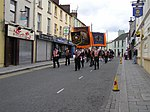 12th July Celebrations, Omagh (27) Coming along John Street, only a handful of bemused observers filtered out from a pub to watch the marchers.