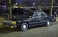 1986 Ford LTD Crown Victoria (fleet), front left at night.jpg