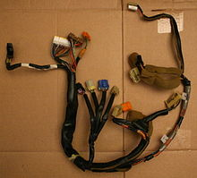 220px-2008-04-17_Geo_Storm_instrument_cluster_wiring_harness Where Is The Wiring Harness on pet harness, pony harness, dog harness, suspension harness, fall protection harness, battery harness, safety harness, obd0 to obd1 conversion harness, engine harness, amp bypass harness, nakamichi harness, electrical harness, maxi-seal harness, radio harness, alpine stereo harness, oxygen sensor extension harness, cable harness,