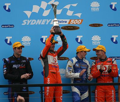 Jamie Whincup (second from left), the most successful driver in the category's history, celebrates winning the 2011 series. 2011 V8s top 4.JPG