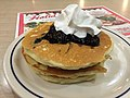 2017-12-19 06 04 19 Stack of pancakes topped with blueberries and whipped cream at an International House of Pancakes along U.S. Route 50 (Lee Jackson Memorial Highway) at Metrotech Drive in Chantilly, Fairfax County, Virginia.jpg
