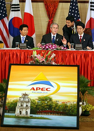 Asia-Pacific Economic Cooperation - Former South Korean President Roh Moo-hyun with Japanese Prime Minister Shinzō Abe and Former U.S. President George W. Bush at APEC 2006 in Hanoi, Vietnam.