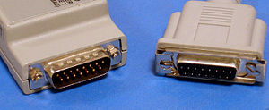 Attachment Unit Interface - AUI Connectors. The male connector (left) is on the MAU and the female connector (right) is on the MAC device (normally either a computer or an Ethernet hub)