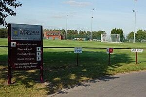 Bodymoor Heath Training Ground - Aston Villa signage at Bodymoor Heath. Note the tennis courts, behind the goalpost.