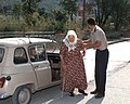 A Federal police officer assists a Bosnian citizen in making her way to the Blagaj polling location so that she may place her vote in the Mostar general elections - DPLA - eccf1da9d2634d267381361bd4624056.jpeg