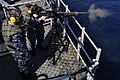 A Sailor fires an M-240B machine gun. (7929360102).jpg
