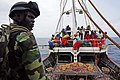 A Senegalese navy boarding officer directs a joint boarding team of U.S. Coast Guardsmen and Senegalese sailors while conducting a routine inspection of a fishing vessel operating in Senegal's exclusive economic 120625-N-GN377-003.jpg