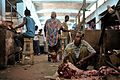 A Somali man carves up a piece of meat in Hamar Weyne's meat market in Mogadishu on October 3, ahead of Eid al-Adha. AMISOM Photo - Tobin Jones (15424403931).jpg