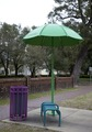 A colorful bench, umbrella and trash can adorn the city streets in many places in Mobile, Alabama LCCN2010637095.tif