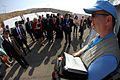A group of high-level dignitaries from a range of countries are briefed about the IFE14 base of operations near the Dead Sea in Jordan (15608607278).jpg