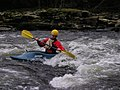 A kayaker surfing a wave on the rapids by Halton - geograph.org.uk - 225522.jpg