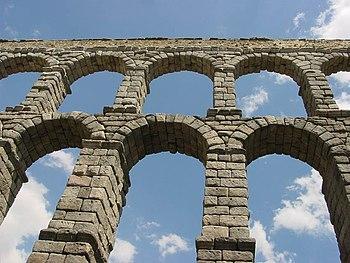 The Ancient Roman aqueduct in Segovia, Spain, ...