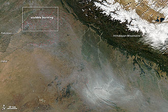 Smog - During the autumn and winter months, some 500 million tons of crop residue are burnt, and winds blow from India's north and northwest towards east. This aerial view shows India's annual crop burning, resulting in smoke and air pollution over Delhi and adjoining areas.