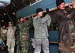 Afghan National Army Air Corps look over a refurbished MI-17 helicopter DVIDS68269.jpg