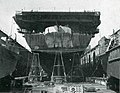 Aft view of USS Lunga Point (CVE-94) in a floating drydock at Guam, in May 1945.jpg