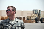 Air Transportation Airmen From the 380th Expeditionary Logistics Readiness Squadron's Air Terminal Operations Center Drives a 60,000-pound-capable Aircraft Loader to Unload a Plane During Operations DVIDS290894.jpg