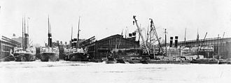 Five American Line steamers are seen laid up in New York in February 1917 after Germany resumed unrestricted submarine warfare. American Line steamers laid up in New York, February 1917.jpg