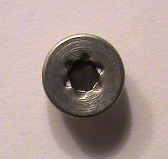 Radionuclide - Americium-241 capsule as found in smoke detector. The circle of darker metal in the center is americium-241; the surrounding casing is aluminium.