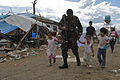 An Armed Forces of the Philippines soldier directs displaced personnel to Tacloban Air Field Nov. 16 during Operation Damayan 131116-M-DG262-094.jpg