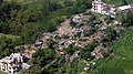 An aerial view of damaged houses occurred due to a recent massive earthquake in Nepal, taken by the Indian Air Force (IAF) helicopter on its way to Dhadhing.jpg