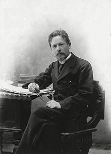 Chekhov seated at a desk
