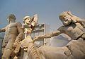 Apol·lo, Teseu i centaure, frontó occidental del temple de Zeus, Museu Arqueològic, Olímpia.JPG