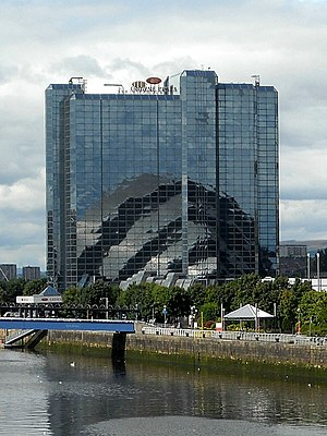 Crowne Plaza Glasgow - Crowne Plaza tower on the banks of the River Clyde, with the reflection of the Clyde Auditorium on its east face.  Bell's Bridge is in the foreground