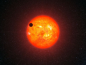 Gliese 1214 b - This artist's impression shows how GJ 1214 b may look as it transits its parent star. It is the second super-Earth for which astronomers have determined the mass and radius, giving vital clues about its structure.