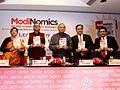 "Arun Jaitley releasing the book ""ModiNomics – Inclusive Economics, Inclusive Governance"", in New Delhi.jpg"