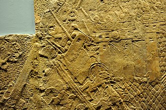 Military history of the Neo-Assyrian Empire - Assyrian siege-engine attacking the city wall of Lachish, part of the ascending assaulting wave. Detail of a wall relief dating back to the reign of Sennacherib, 700–692 BC. From Nineveh, Iraq, currently housed in the British Museum