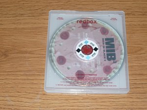 Redbox - Back of a Redbox Blu-ray tray; with a Men in Black 3 disk