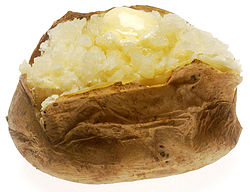 Baked potato wikipedia bakedpotatowithbutterg a baked potato with butter ccuart Images