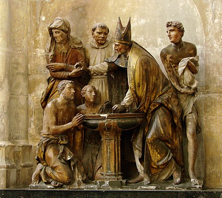 Baptism of Augustine of Hippo as represented in a sculptural group in Troyes Cathedral (1549), France Bapteme Cathedrale de Troyes 290308.jpg