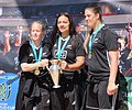 Black Ferns Kendra Cocksedge, Stacey Waaka, Eloise Blackwell with Women's Rugby World Cup trophy and WRWC medals.jpg