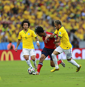 Juan Cuadrado - Cuadrado and Brazil's Neymar and Marcelo competing for the ball at the 2014 FIFA World Cup