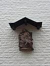 foto van Hoekpand, afgedekt door een schilddak met brede lijstgevels aan het Vrijthof en Bredestraat.