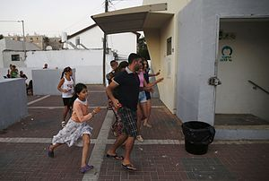 Timeline of the 2014 Israel–Gaza conflict - Israeli residents of Ashkelon run for shelter during a rocket alert.
