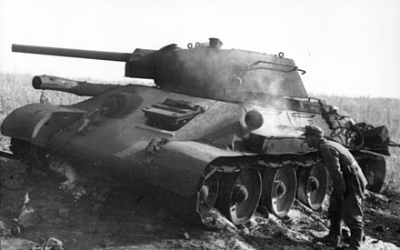 A German soldier inspects a knocked out T-34 during the Battle of Kursk at Pokrovka, which is 40 kilometres (25 mi) southwest of Prokhorovka. Bundesarchiv Bild 101I-219-0553A-36, Russland, bei Pokrowka, russischer Panzer T34.jpg