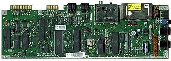 """A C64C motherboard (""""C64E"""" Rev B PAL 1992)."""