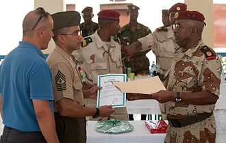 Combined Joint Task Force – Horn of Africa - Djiboutian Army Major Ahmed Said Guedi presents a letter of appreciation to CJTF-HOA and USAFRICOM Command Sergeant Major Scott Mykoo in September 2011.