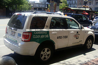 Hybrid taxi - Cambridge's Clear Air Cab hybrid taxis display a green livery to identify the vehicles participating in the program.