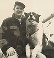 Capt. Lou Kennedy aboard the schooner VEMA with his dog Gotlik.jpg