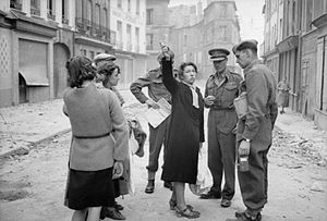 John Crocker - Lieutenant General John Crocker talking to some of the liberated civilians during his tour of Caen, Normandy, July 1944.