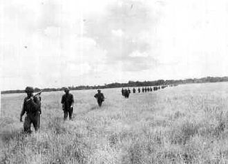 Carlson's patrol - Carlson's raiders cross an open field during the patrol